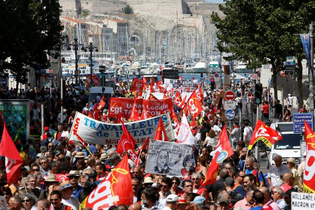 General view of French trade union employees who march with banners during a demonstration against plans to reform French labour laws in Marseille